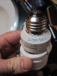 CFL bulb with installation date written on base