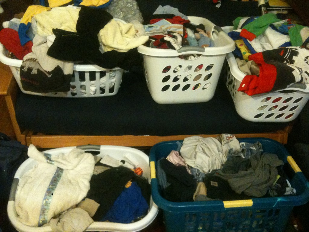 5 baskets of clean laundry to fold
