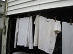 Shirts hanging at edge of roof