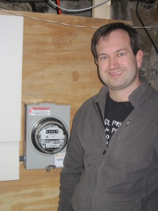 Jon standing next to our solar meter