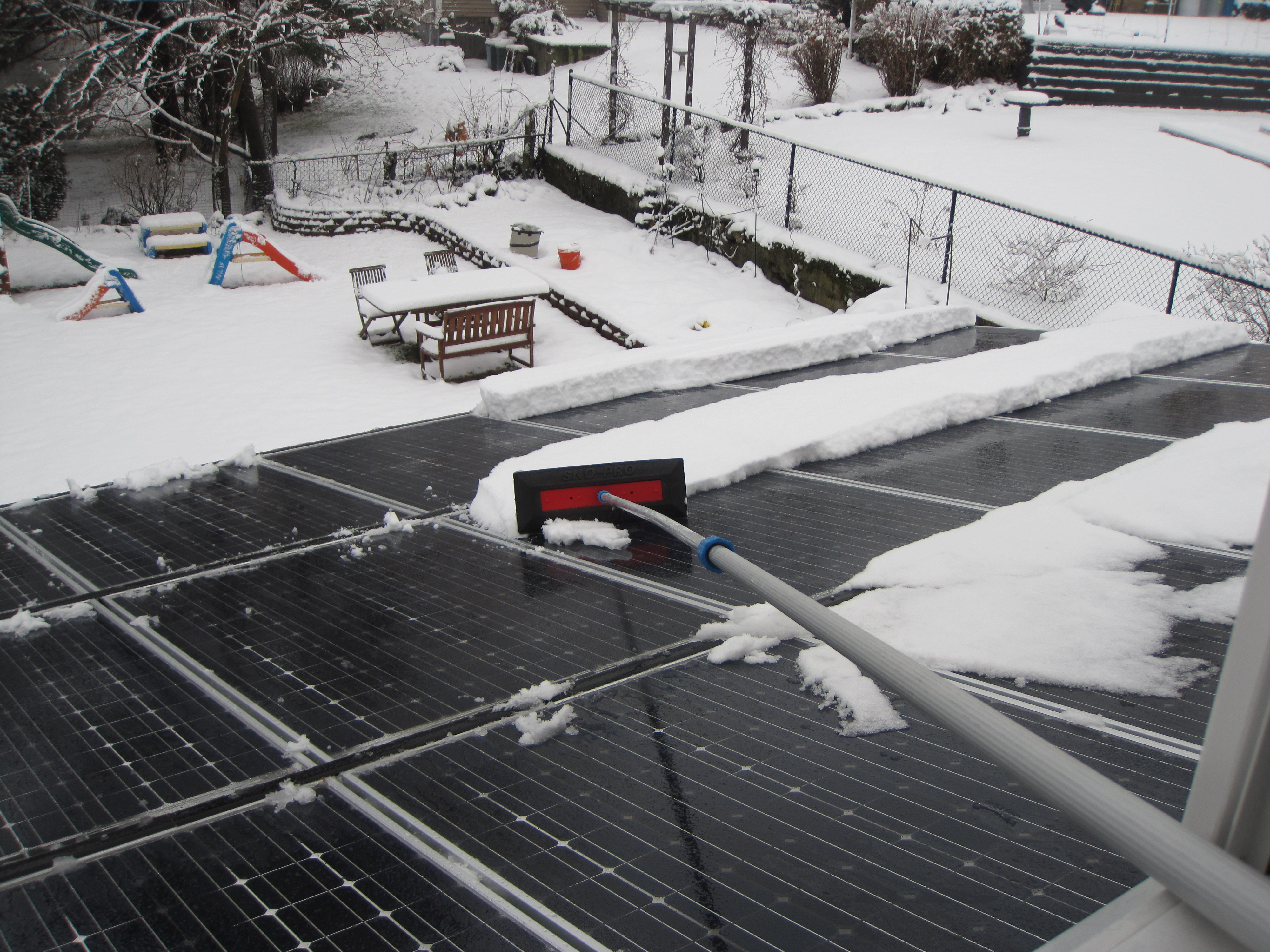 Going For Solar Removing Snow From Solar Panels Green