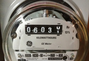 analog electricity meter shwoing 6,030 kWh