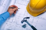 blueprint, yellow hardhat, hammer