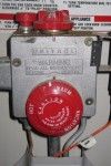 red hot water heater dial set to warm