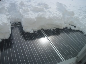 removing snow from solar panels