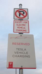 signs saying No Parking except for electric vehicles, reserved for Tesla Vehicle Chargin