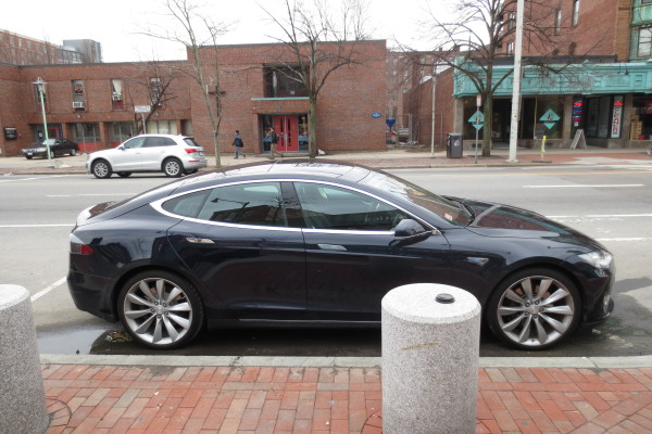 Black Tesla Model S view from the side