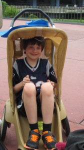 8 year old sitting in Disney stroller