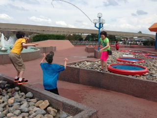 Children Playing with the jumping water in Epcot