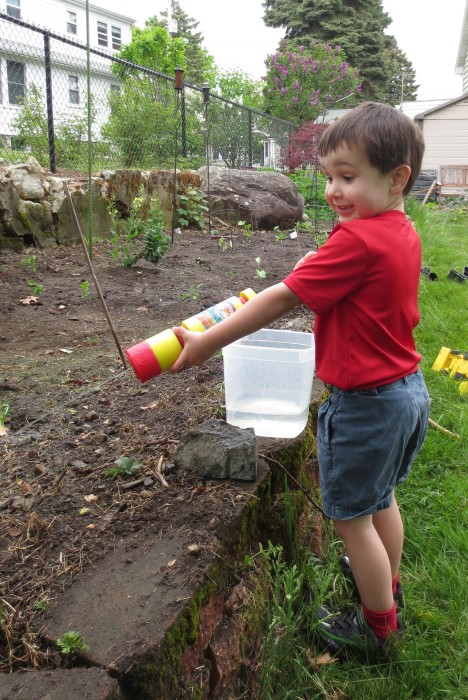 Timmy watering the garden with his squirter
