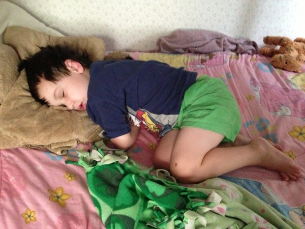 child sleeping on a bed