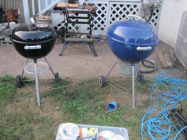 small black & large blue charcoal kettle grills