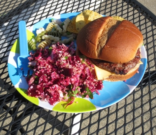 colorful grilled hamburger with beet salad