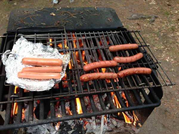 organic hot dogs on the grill