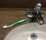 Toothbrush next to sink