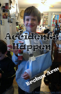 boy with broken arm in a sling