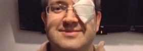 Jonathan with glasses and gauze over his left eye