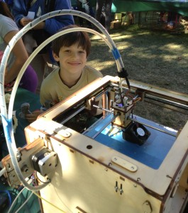 boy watching 3D Printer in action