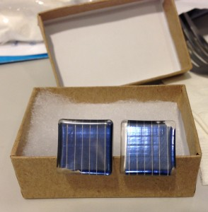 blue solar panel cuff links in brown paper box