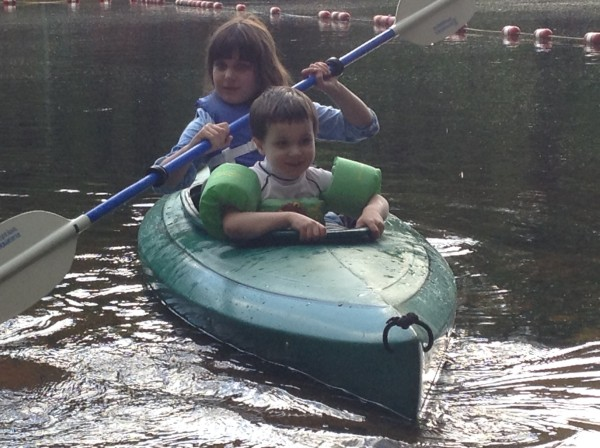 kids in a kayak