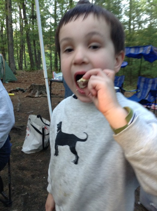 Timmy eating s'mores