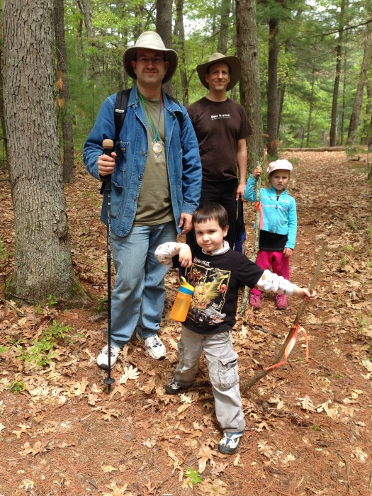 Two dads and their 5 year olds going for a hike in the woods.