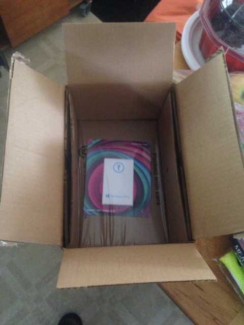 small plastic card packed in a big box