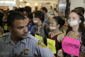 Protesters with tape over their mouths at COP16