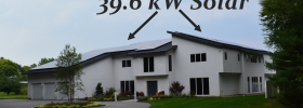Photo of home with both roofs covered in solar panels