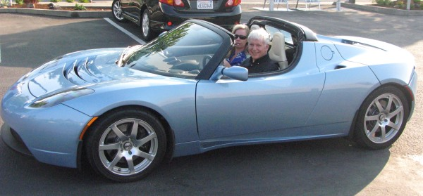 sky blue Tesla Roadster with Jeff Sutherland and Gabrielle Benefield