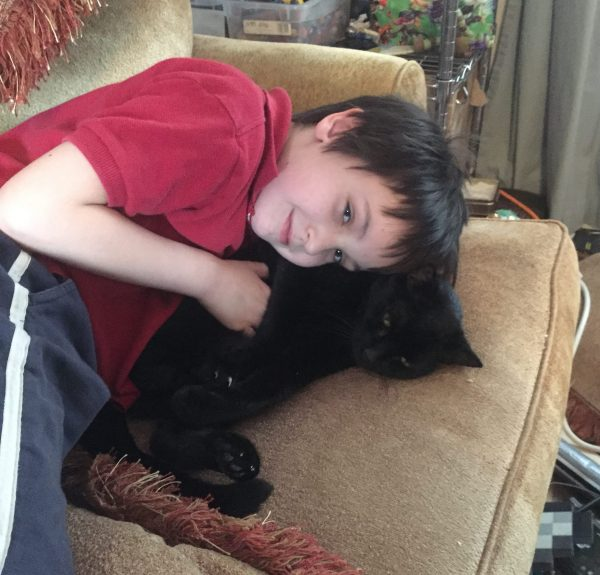 kid and cat on couch